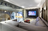 modern-ideas-pleasing-interior-glass-walls-for-homes-with-fabulous-modern-wall-units-huge-treatment-and-white-sectional-sofa-also-chest-coffee-table-awesome-decoratio